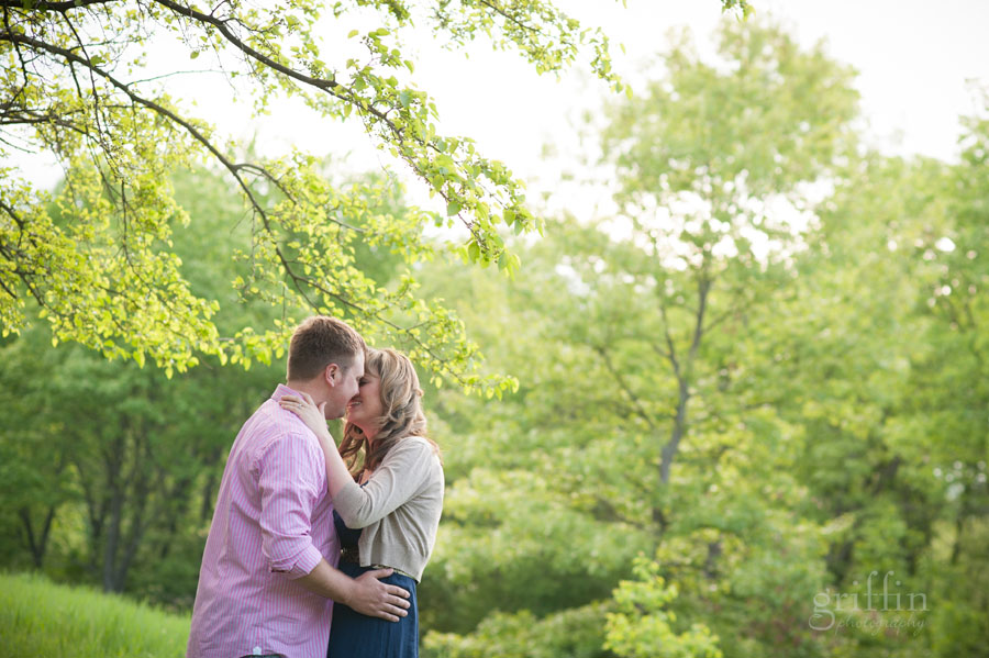 dreamy bokeh kissing engagement session trees