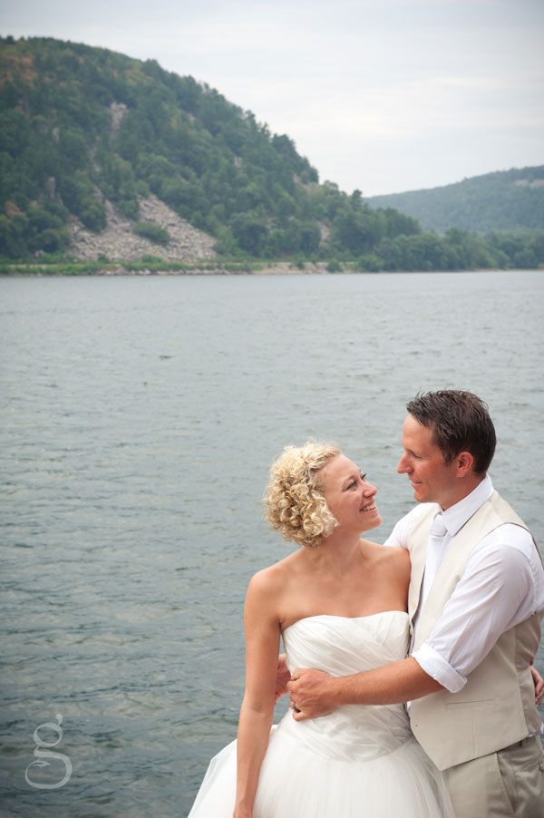 devil's lake behind the bride and groom off rock 9 at the lake, wisconsin.