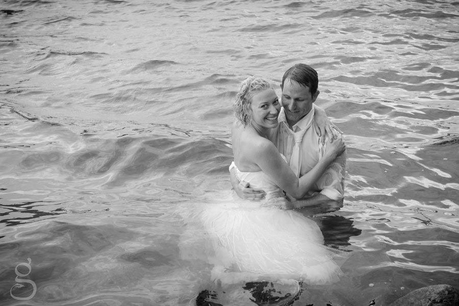 Trash the dress day after wedding session bride and groom in the lake.