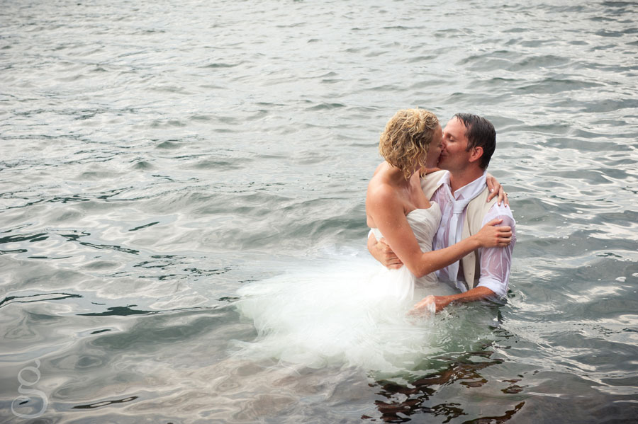 josh and laura kissing in the water.