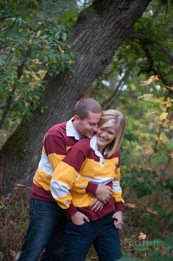 Minnesota alumni giggling in the woods