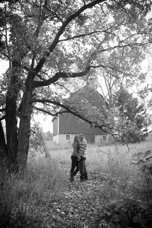 couple in front of the family barn, blueberry farm.
