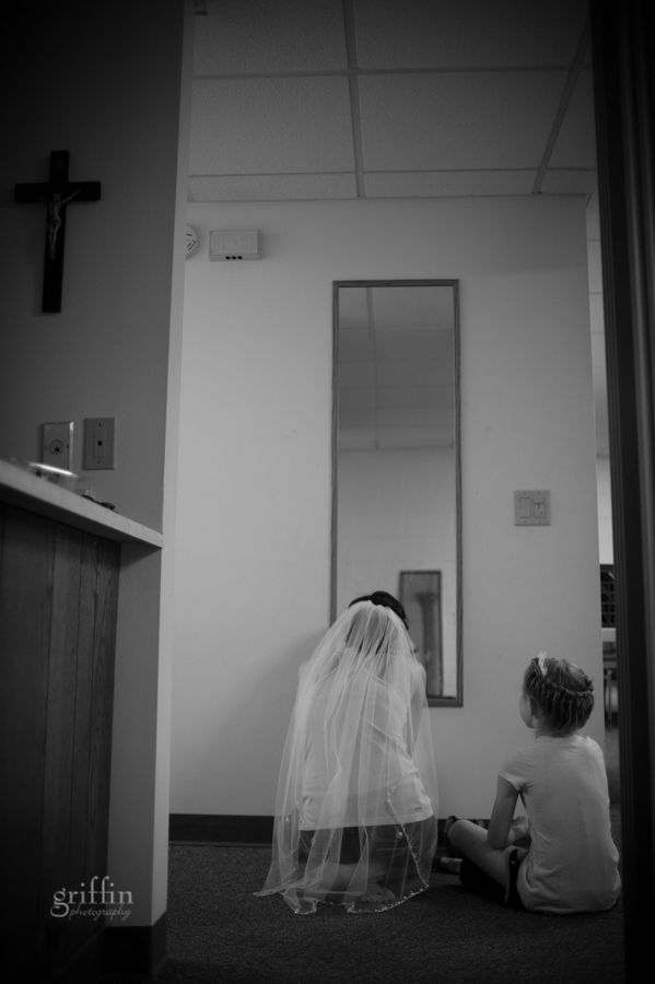 bride and flower girl getting ready before a full length mirror