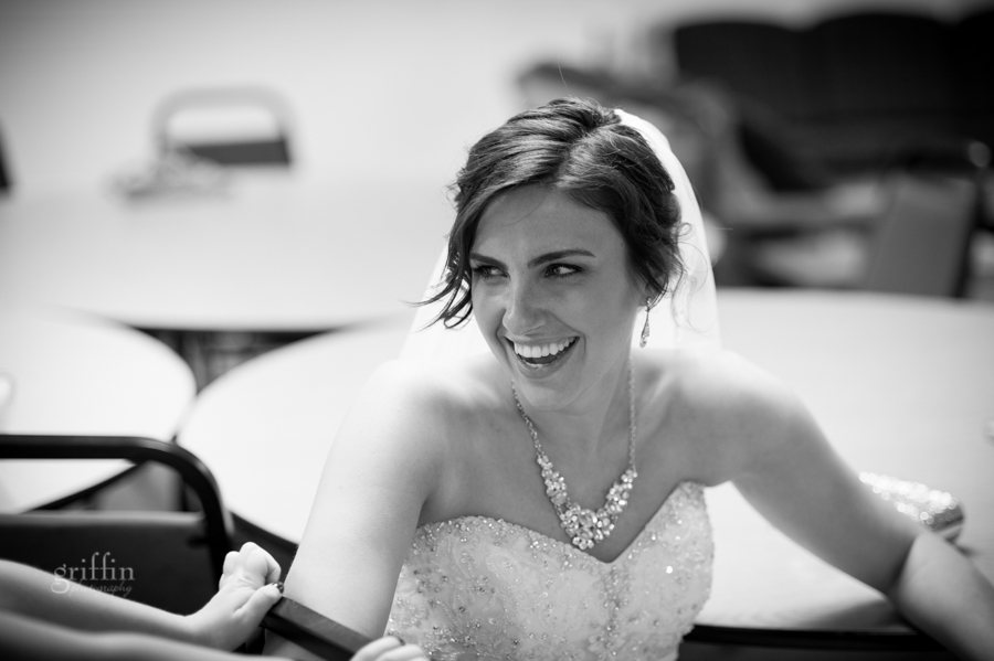 beautiful bride Marissa laughing before the ceremony