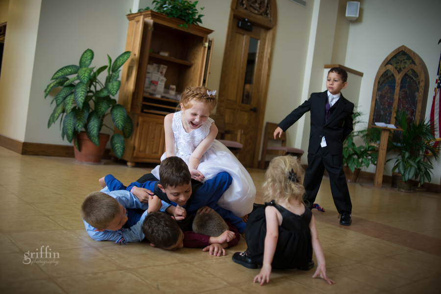 the flower girl tackling the boys.
