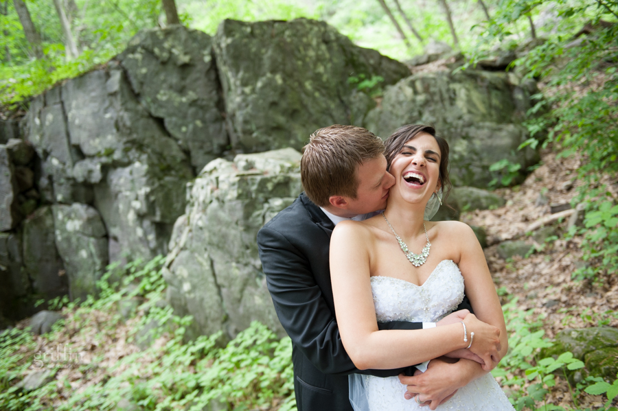 laughing, giggling and hugging bride and groom.