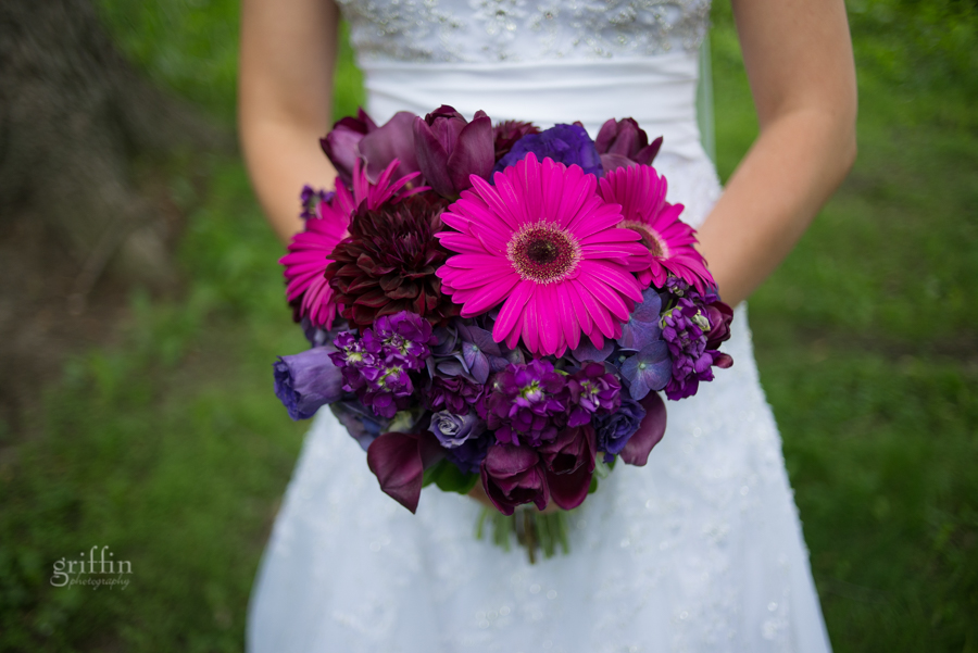 purple bridal bouquet, gerbera daisies, roses and lilies.