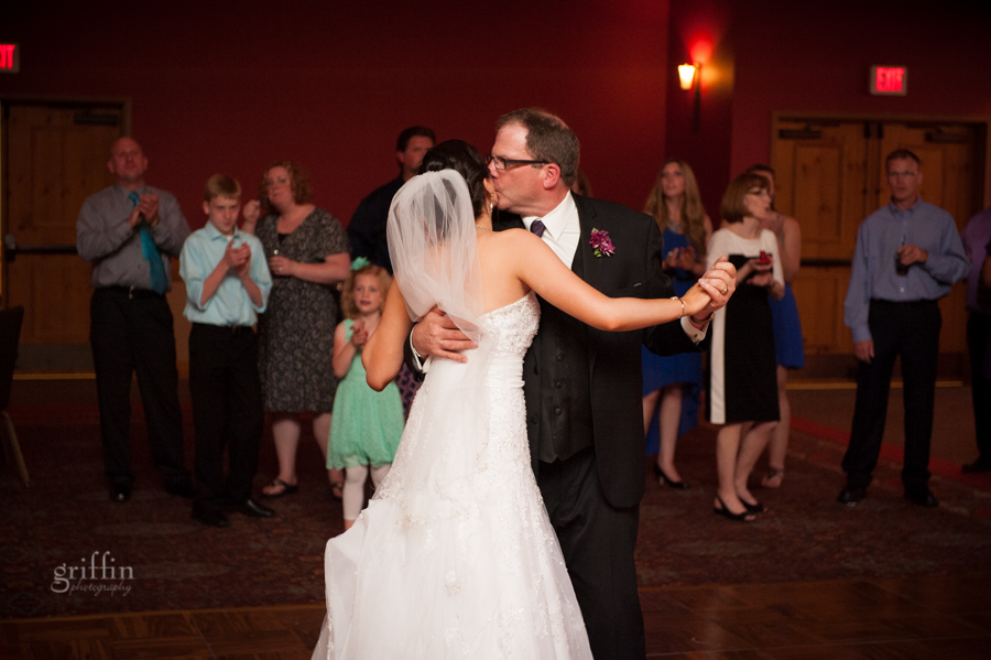 father daughter dance with a last kiss.