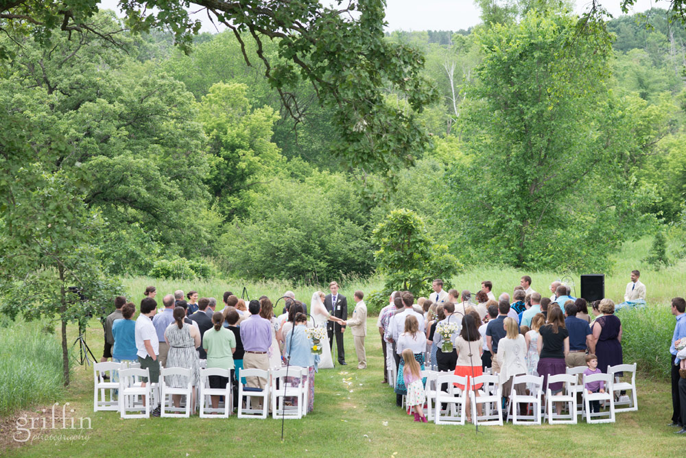 white folding chairs bakyard wedding