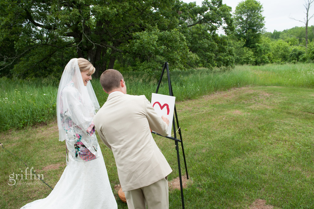 newly married ocuple painting unity painting