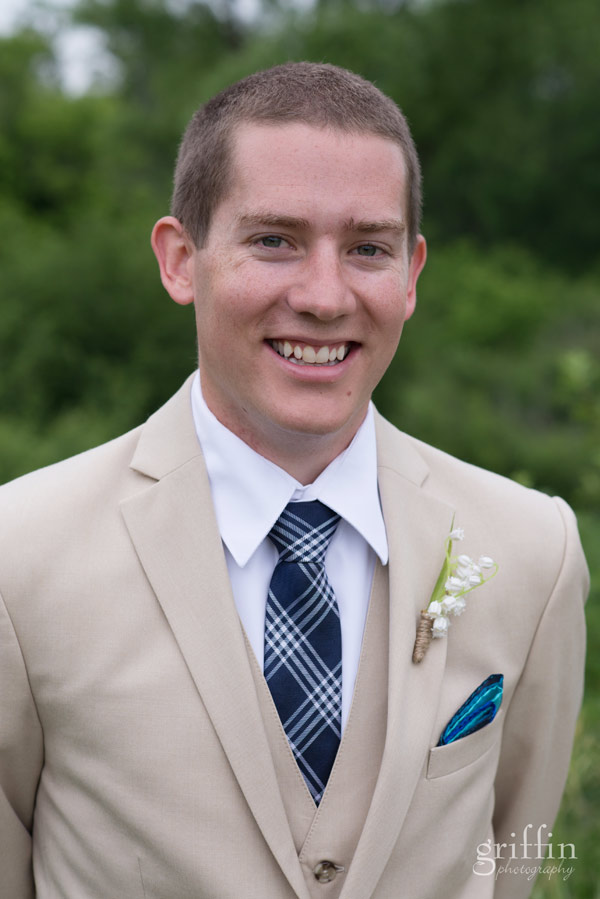 handsome groom in blue tie