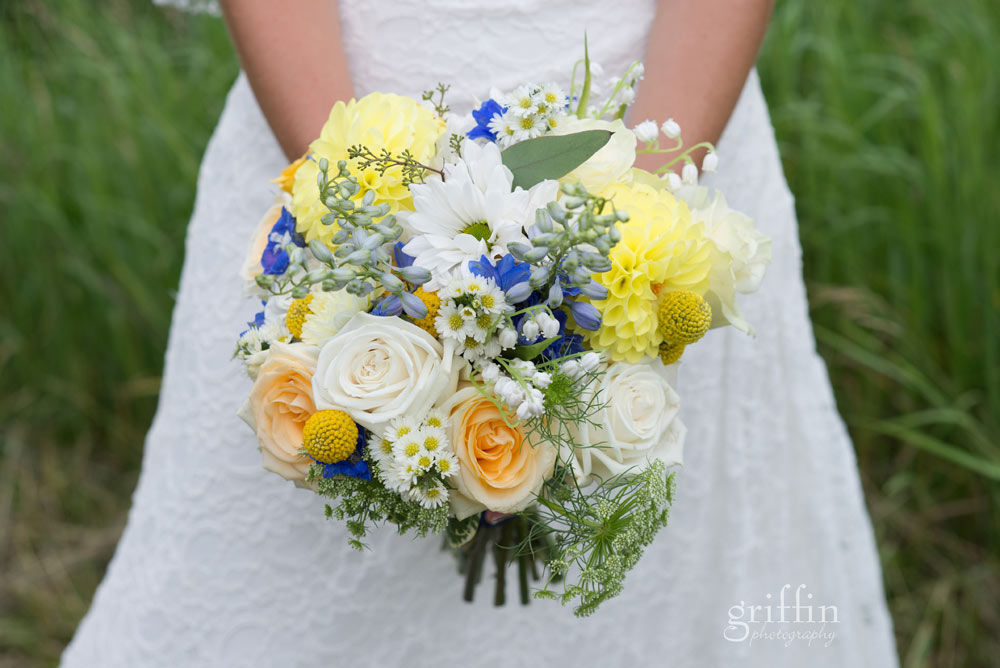 yellow and blue floral bouquet with roses
