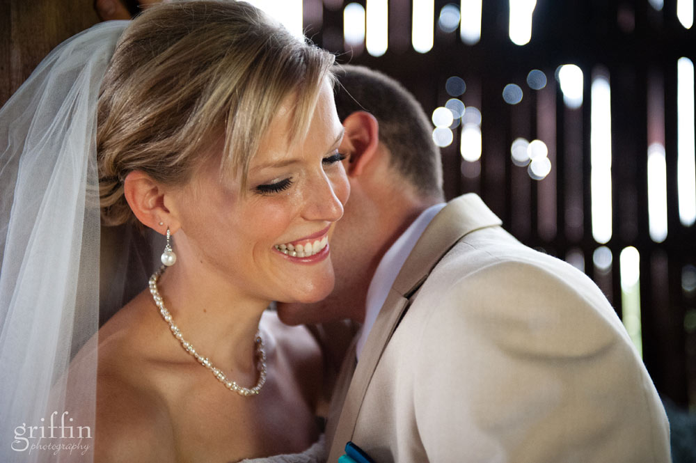 groom nuzzling his bride's neck
