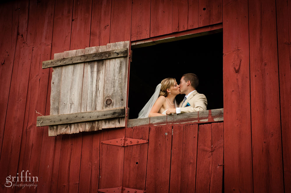 open red barn door with couple in the window