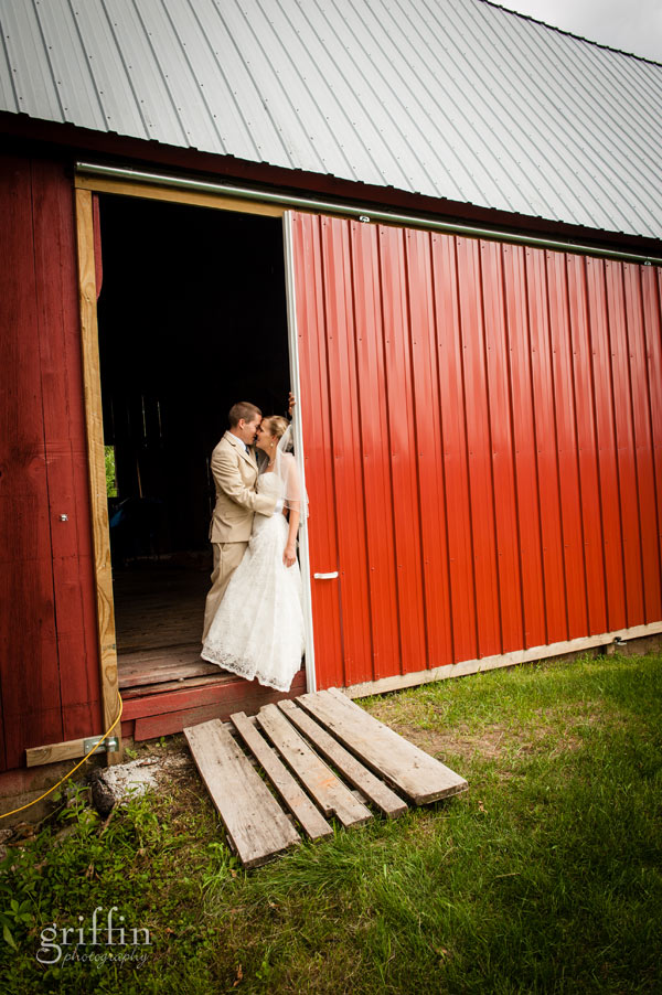 red barn wedding day kisses