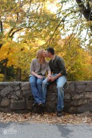 Engaged couple kissing on rock ledge at Devil's Lake, baraboo wis.