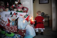 Mrs. Claus keeping the little one entertained.