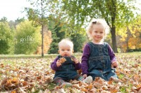 Two little girls playing in the leaves at Devil's Lake in Baraboo, Wisconsin.