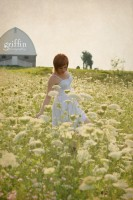 Senior student walking through field of Queen Anne's lace in Baraboo, Wisconsin.