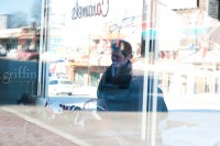 man and woman reflected in candy store window in downtown dells.