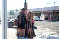 Kissing couple reflected in glass window in the Dells.