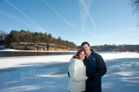 Engaged couple along the Wisconsin River in Wisconsin Dells.