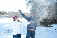 throwing snow up in the air.