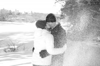 kissing while being pelted with snow.
