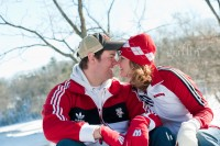 Engaged couple showing off their Wisconsin pride.