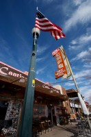 Coffe Cup Cafe sign and American flag in Arizona.