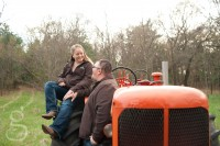 Smiles while sitting on the tractor.