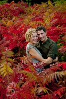 Hugging couple in love surrounded by red.