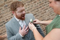 the groom faking pain when the maid of honor pins on the boutonierre.