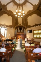 gorgeous light filtering into the sanctuary of the church during the ceremony.