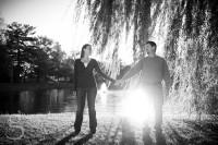 black and white of the couple holding hands.