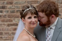 The groom sniffing his beautiful bride's ear.