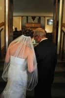Emilie and her dad waiting to head down the aisle.