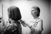 Barb having her sister do her hair before the wedding.