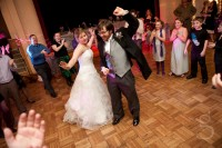 the bride and groom getting down on the dance floor.