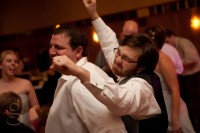 groom and new brother in law on the dance floor.