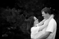 black and white shot of the engaged couple looking at each other.